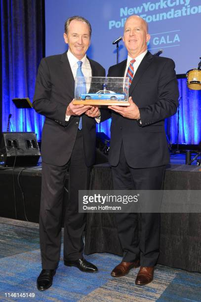 James P Gorman and New York City Police Commissioner James P O'Neill pose onstage during the 2019 New York City Police Foundation Gala at New York...