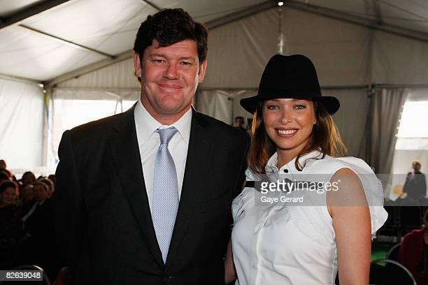 James Packer and Wife Erica Baxter pose at the ceremony as Crown Princess Mary of Denmark makes a presentation onstage as she opens the new Victor...