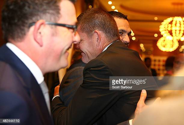 James Packer Crown Resorts Chairman embraces Greg Inglis South Sydney Rabbitohs NRL captain during the launch of Crown Resorts' second Reconciliation...
