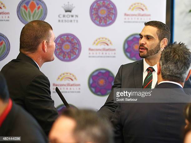 James Packer Crown Resorts Chairman shakes hands with Greg Inglis South Sydney Rabbitohs NRL captain during the launch of Crown Resorts' second...
