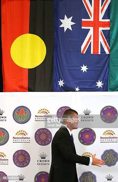 James Packer Crown Resorts Chairman walks on stage under an Australian Aboriginal Flag an Australian Flag and a Torres Strait Islander flag as he...