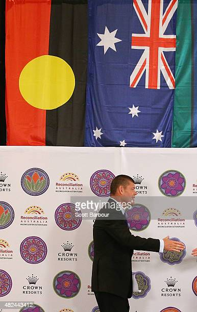 James Packer Crown Resorts Chairman walks on stage under an Australian Aboriginal Flag and an Australian Flag as he launches Crown Resorts' second...