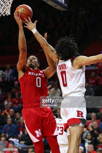 James Palmer Jr #0 of the Nebraska Cornhuskers attempts a layup as Geo Baker of the Rutgers Scarlet Knights defends during the second half of a game...