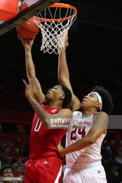 James Palmer Jr #0 of the Nebraska Cornhuskers attempts a layup as Ron Harper Jr #24 of the Rutgers Scarlet Knights defends during the first half of...