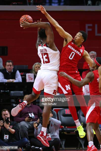 James Palmer Jr #0 of the Nebraska Cornhuskers attempts to block a shot by Shaq Carter of the Rutgers Scarlet Knights during the second half of a...