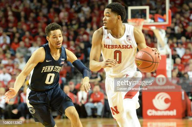 James Palmer Jr #0 of the Nebraska Cornhuskers drives past Myreon Jones of the Penn State Nittany Lions at Pinnacle Bank Arena on January 10 2019 in...