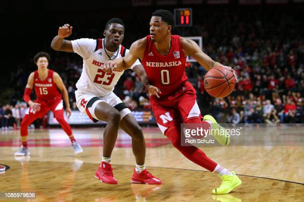 James Palmer Jr #0 of the Nebraska Cornhuskers drives to the basket as Montez Mathis of the Rutgers Scarlet Knights defends during the first half of...