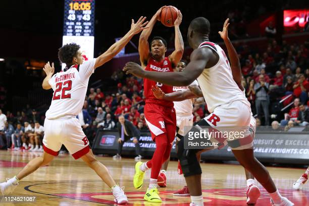 James Palmer Jr #0 of the Nebraska Cornhuskers in action against Caleb McConnell and Eugene Omoruyi of the Rutgers Scarlet Knights during a game at...