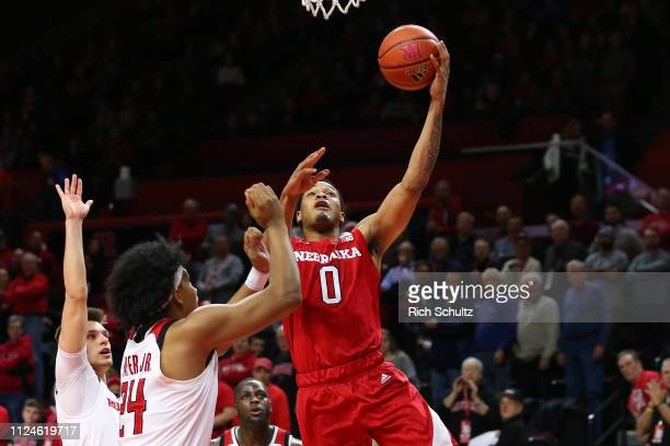James Palmer Jr #0 of the Nebraska Cornhuskers in action against Ron Harper Jr #24 of the Rutgers Scarlet Knights during a game at Rutgers Athletic...