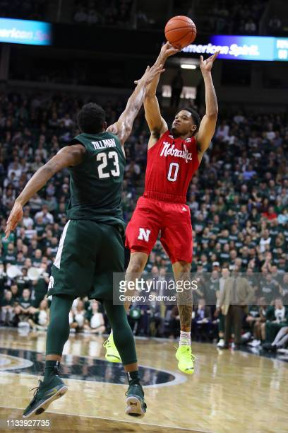 James Palmer Jr #0 of the Nebraska Cornhuskers takes a shot over Xavier Tillman of the Michigan State Spartans at Breslin Center on March 05 2019 in...