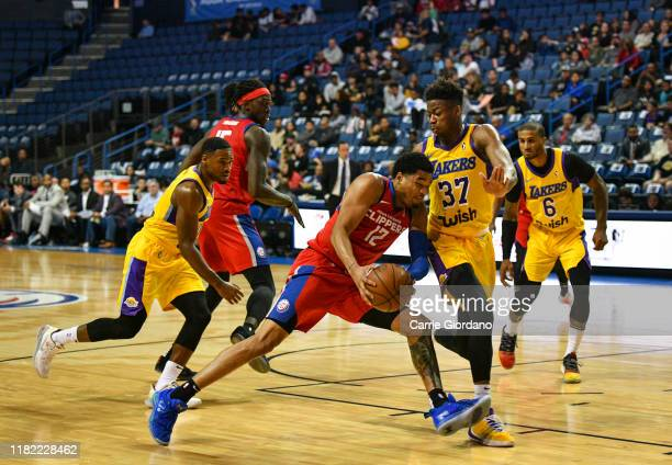 James Palmer Jr of the Agua Caliente Clippers tries to push past defender Kostas Antetokounmpo of the South Bay Lakers during a game at The Toyota...