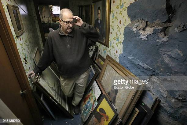James Pantages stands among part of his collection of more than 1100 pieces of artwork at his home in Quincy MA on April 2 2018 For many years...