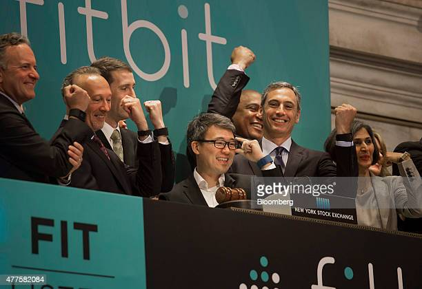 James Park chief executive officer of Fitbit Inc center rings the opening bell before the company's initial public offering on the floor of the New...