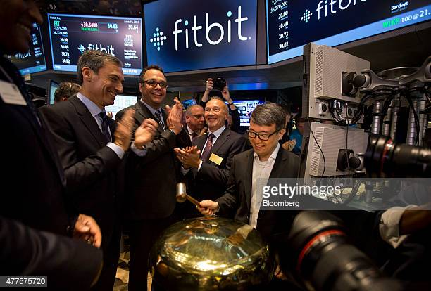 James Park chief executive officer of Fitbit Inc right rings a ceremonial bell during the company's initial public offering on the floor of the New...