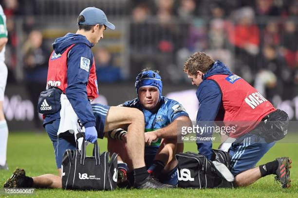 James Parsons of the Blues receives medical help during the round 5 Super Rugby Aotearoa match between the Crusaders and the Blues at Orangetheory...