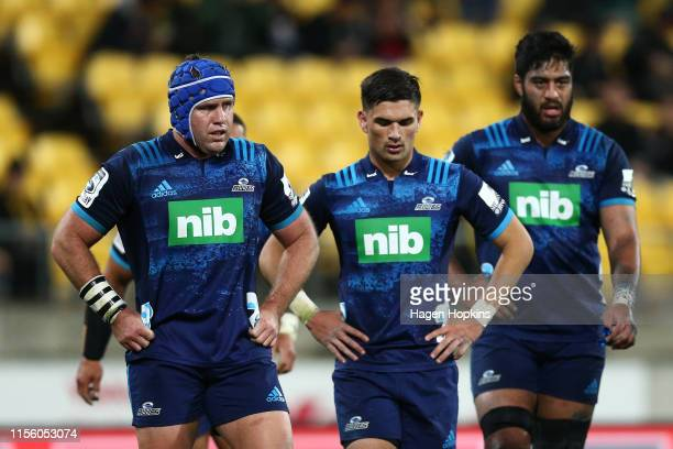 James Parsons Otere Black and Akira Ioane of the Blues look on in disappointment after a Hurricanes try during the round 18 Super Rugby match between...