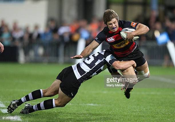 James Paterson of Canterbury gets tackled by Israel Dagg of Hawks Bay during the Air New Zealand Cup match between the Hawkes Bay Magpies and...
