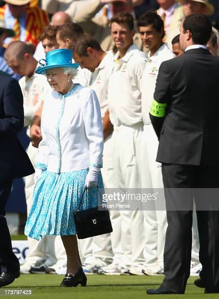 James Pattinson and Ashton Agar of Australia look on after meeting Queen Elizabeth II during day one of the 2nd Investec Ashes Test match between...