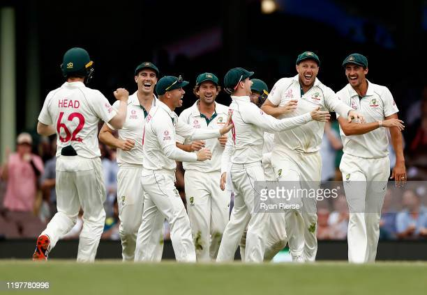 James Pattinson of Australia celebrates after taking a catch to Todd Astle of New Zealand dismiss off the bowling of Nathan Lyon of Australia during...
