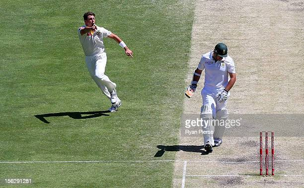 James Pattinson of Australia celebrates after taking the wicket of Graeme Smith of South Africa during day five of the First Test match between...