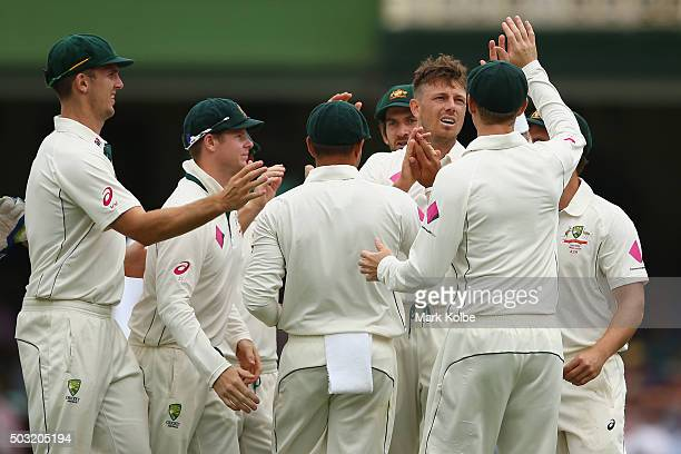 James Pattinson of Australia celebrates after taking the wicket of Darren Bravo of West Indies during day one of the third Test match between...