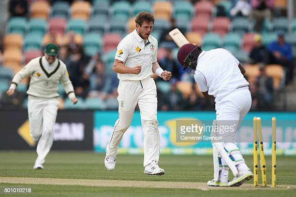 James Pattinson of Australia celebrates dismissing Darren Bravo of the West Indies during day three of the First Test match between Australia and the...
