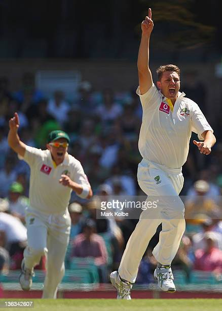 James Pattinson of Australia celebrates taking the wicket of Gautam Gambhir of India during day one of the Second Test Match between Australia and...