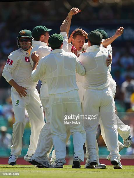 James Pattinson of Australia celebrates with his team mates after taking the wicket of Gautam Gambhir of India during day one of the Second Test...