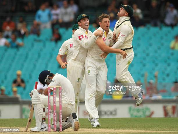 James Pattinson of Australia celebrates with team mates Shaun Marsh and David Warner after taking the wicket of Virat Kohli of India during day four...