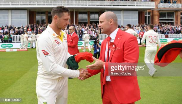 James Pattinson of Australia presents former England captain Andrew Strauss with his red cap ahead of day two of the 2nd Specsavers Ashes Test match...