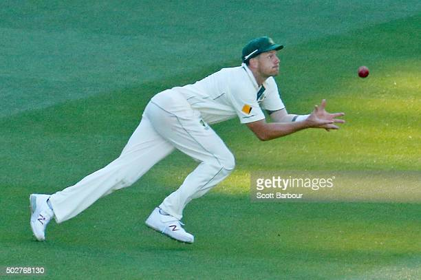 James Pattinson of Australia takes a catch to dismiss Jerome Taylor of the West Indies and to win the match during day four of the Second Test match...