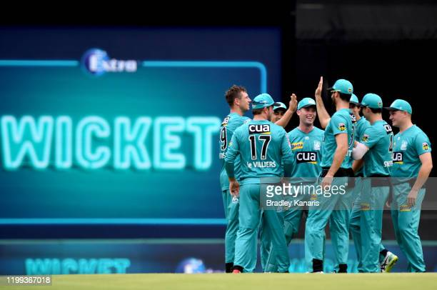 James Pattinson of the Heat celebrates with team mates after taking the wicket of Harry Nielsen of the Strikers during the Big Bash League match...