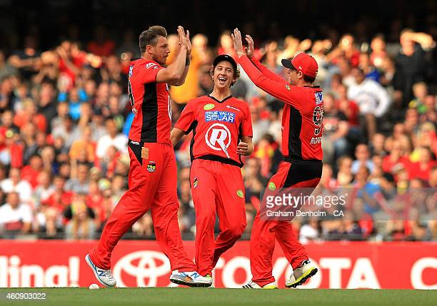 James Pattinson of the Melbourne Renegades is congratulated by team mates after taking the wicket of Jacques Kallis of the Sydney Thunder during the...