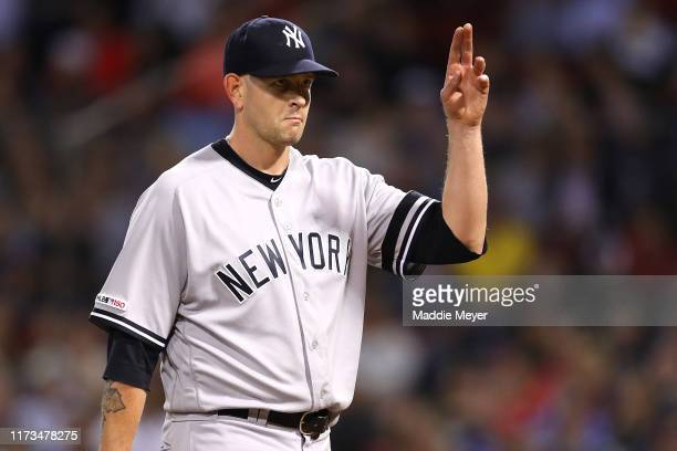 James Paxton of the New York Yankees acknowledges the crowd after being relieved during the seventh inning of the game between the Boston Red Sox and...