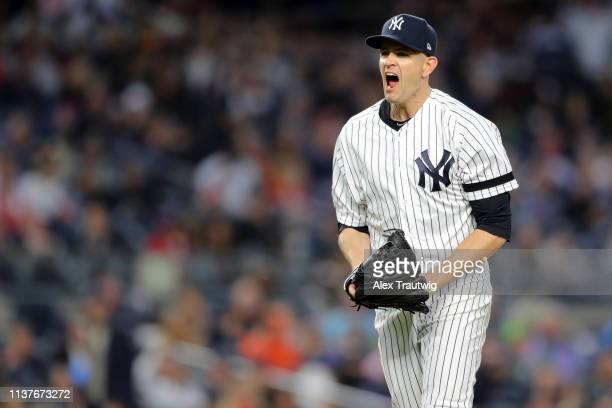 James Paxton of the New York Yankees reacts to striking out Mitch Moreland of the Boston Red Sox to end the top of the fourth inning during the game...