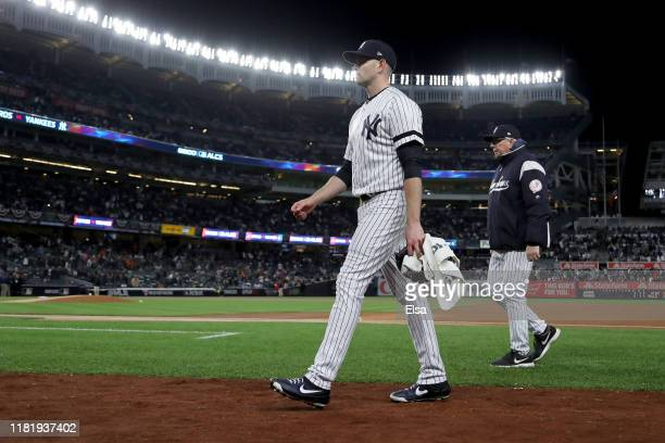 James Paxton of the New York Yankees walks back to the dugout prior to game five of the American League Championship Series against the Houston...