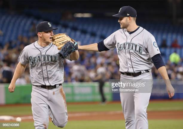 James Paxton of the Seattle Mariners congratulates Kyle Seager after making a solid defensive play to preserve his nohitter in the seventh inning...