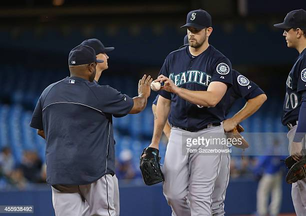 James Paxton of the Seattle Mariners exits the game as he is relieved by manager Lloyd McClendon in the third inning during MLB game action against...
