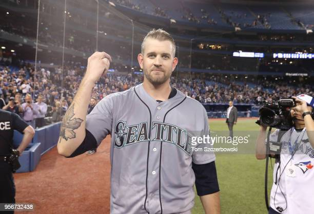 James Paxton of the Seattle Mariners holds the ball with which the final out was recorded after throwing a nohitter during MLB game action against...