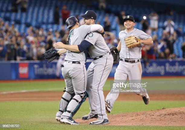 James Paxton of the Seattle Mariners is congratulated by Mike Zunino and teammates after throwing a nohitter during MLB game action against the...