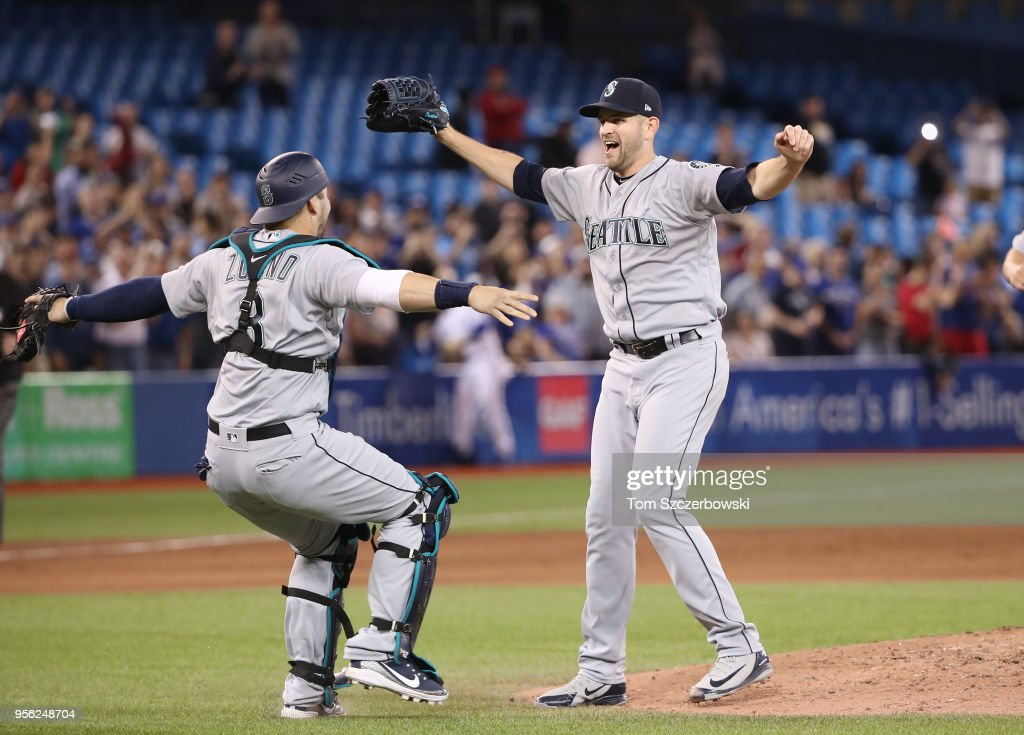 James Paxton #65 of the Seattle Mariners is congratulated by Mike Zunino #3 and teammates after throwing a no-hitter during MLB game action against the Toronto Blue Jays at Rogers Centre on May 8, 2018 in Toronto, Canada.