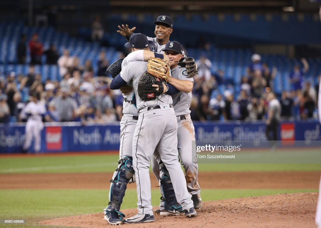 James Paxton #65 of the Seattle Mariners is congratulated by teammates after throwing a no-hitter during MLB game action against the Toronto Blue Jays at Rogers Centre on May 8, 2018 in Toronto, Canada.