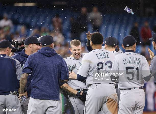 James Paxton of the Seattle Mariners is congratulated by teammates after throwing a nohitter during MLB game action against the Toronto Blue Jays at...