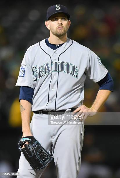 James Paxton of the Seattle Mariners stand on the mound waiting for manager Scott Servais to come take him out of the game after he gave up a tworun...