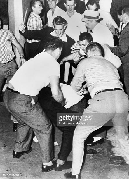 James Peck of New York who was on one of the two Freedom Rider buses is attacked at the bus station Birmingham Alabama May 14 1961 The other bus was...