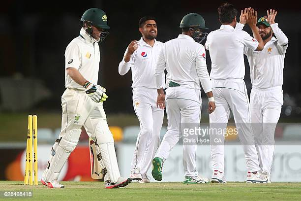 James Peirson of Australia XI is dismissed by Mohammad Amir of Pakistan during the tour match between Cricket Australia XI and Pakistan at Cazaly's...