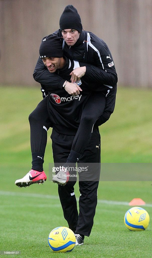 James Perch carries Davide Santon (R) on his back during a Newcastle United Training at The Little Benton training ground on January 04, 2013 in Newcastle upon Tyne, England.