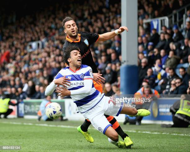 James Perch of Queens Park Rangers is challenged by Atdhe Nuhiu od Sheffield Wednesday during the Sky Bet Championship match between Queens Park...