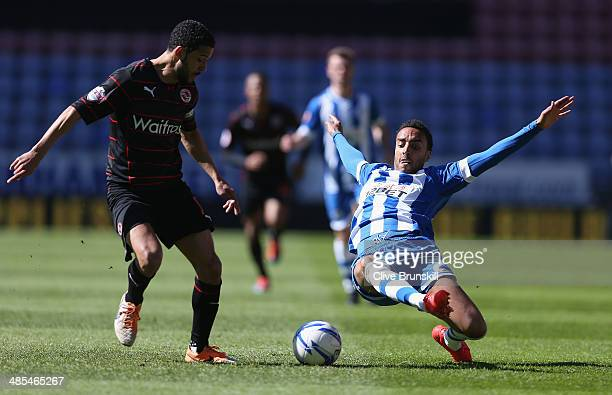 James Perch of Wigan Athletic attempts to tackle Jobi McAnuff of Reading during the Sky Bet Championship match between Wigan Athletic and Reading at...