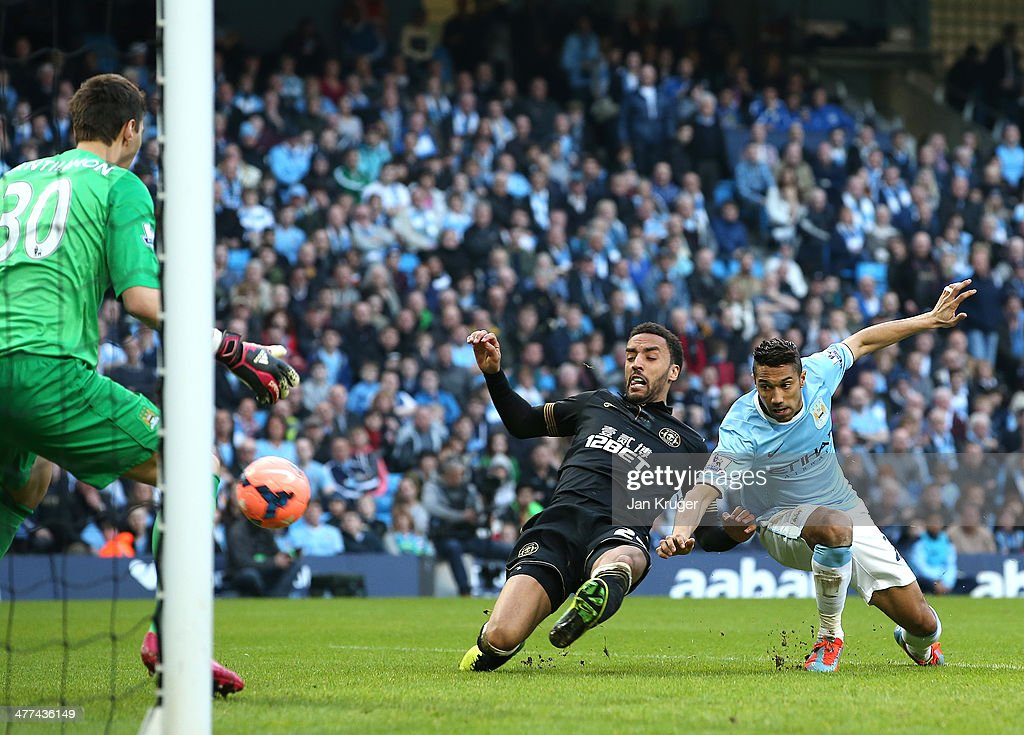 James Perch of Wigan Athletic beats Gael Clichy to the ball for his goal during the FA Cup Quarter-Final match between Manchester City and Wigan Athletic at the Etihad Stadium on March 9, 2014 in Manchester, England.